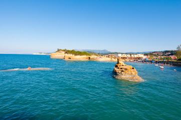 Sidary beach, holidaymakers sunbath on the shore. Corfu, Greece.