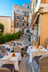 Cosy outside restaurant waits for guests. Corfu, Greece.