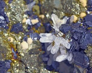 Onwards blue galena and  limpid white quartz
