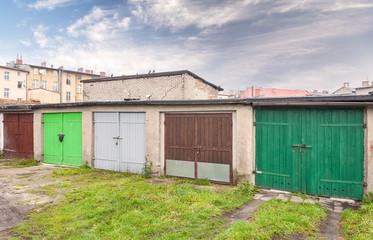 Row of garage doors in slum area.