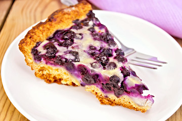 Pie blueberry in plate and napkin on board
