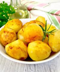 Potatoes fried in plate on board