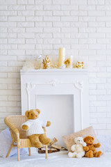 Beautiful interior with decorative fireplace and teddy bears
