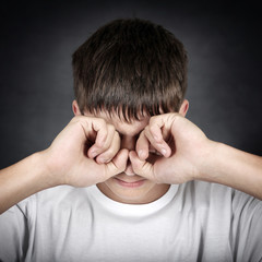 Young Man rub the Eyes