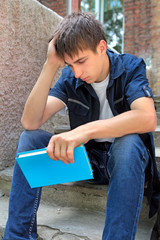 Sad Student with the Book