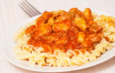 Fusilli pasta with chicken in tomato sauce