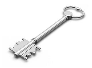 Metal key on white