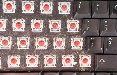 Top view of dismantled dirty keyboard, closeup
