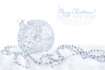 Christmas silver decorations on snow on white background