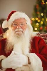 Portrait of cheerful santa with his glasses