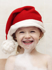 Little happy Santa in the bath full of foam
