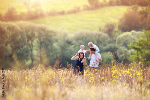 canvas print picture Family enjoying life together outside