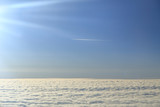Blue sky over the surface of white clouds, aerial photography