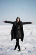 beautiful girl alone in winter field