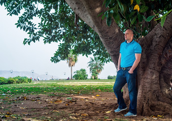 Man poses outside in the park