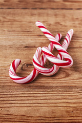 candy canes on weathered wooden board
