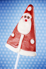 Christmas lollipop isolated on blue background
