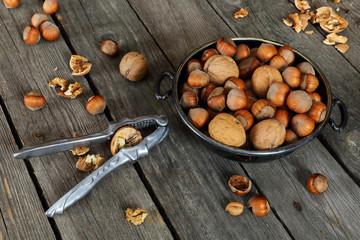 Hazelnuts, walnuts and nutcracker