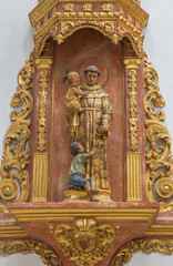 Seville - carved polychrome statue of st. Antony of Padua