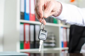 Salesman holding car key