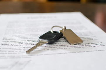 Car key on a signed sales contract