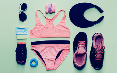 Lady fitness style. Sports Accessory Set on green background