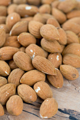 almond nuts on wooden surface