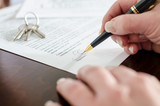 Woman signing a real estate contract