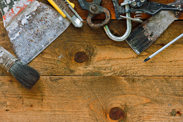 Various old diy tools on rustic work bench