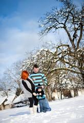 Family in winter time having fun