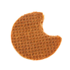 Bite of the typical Dutch stroopwafel (Caramel waffle).