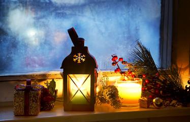 Warm Lantern on Frozen Window with Decoration