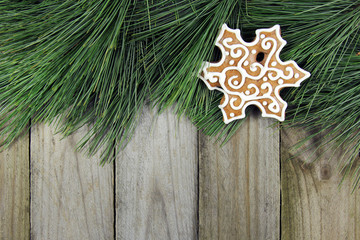 christmas background- fir tree, gingerbread over wooden table