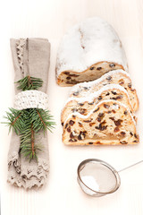 Christmas stollen on light wooden background