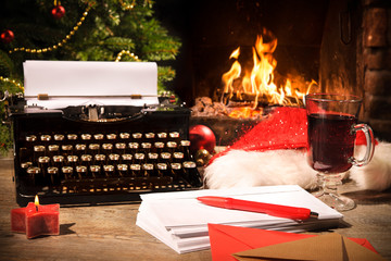 Old typewriter and Santa Claus hat on desk