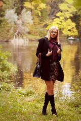 Fashion  happy woman  near the river