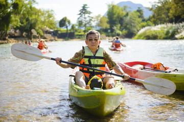 Senior man paddling kayak