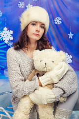 Woman with teddy bears with xmas tree near by