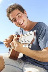 Young men playing guitar