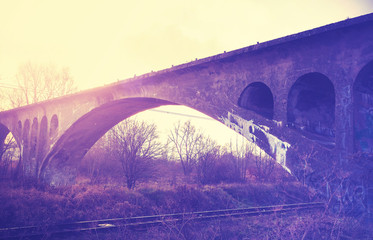 Retro vintage filtered picture of an arch bridge.