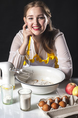 Smiling homemaker in kitchen