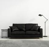 Fototapety Contemporary black leather sofa