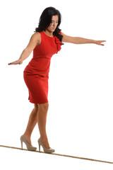 Businesswoman Walking on Tightrope
