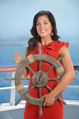 Young Businesswoman Holding Ship Wheel