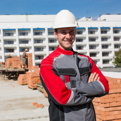 Positive inspector man on construction site background