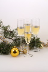 Still-life with champagne both gold spheres and a pine branch
