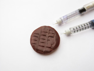 diabetes syringe and chocolate cookies