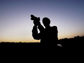 man photographing silhouette