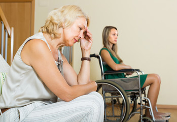 Woman and handicapped female having quarrel