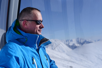 Man in ski gondola